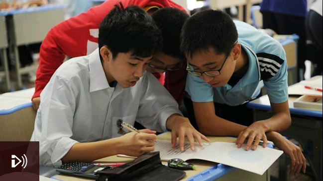 Photo: Schoolboys solving a math problem in class at the Shanghai Number Eight High School. Credit: Peter Parks/AFP/Getty Images